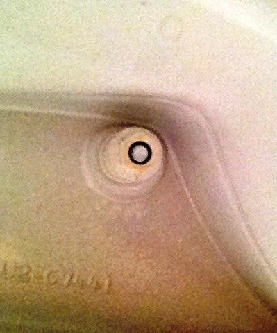 picture of bolt under toilet seat