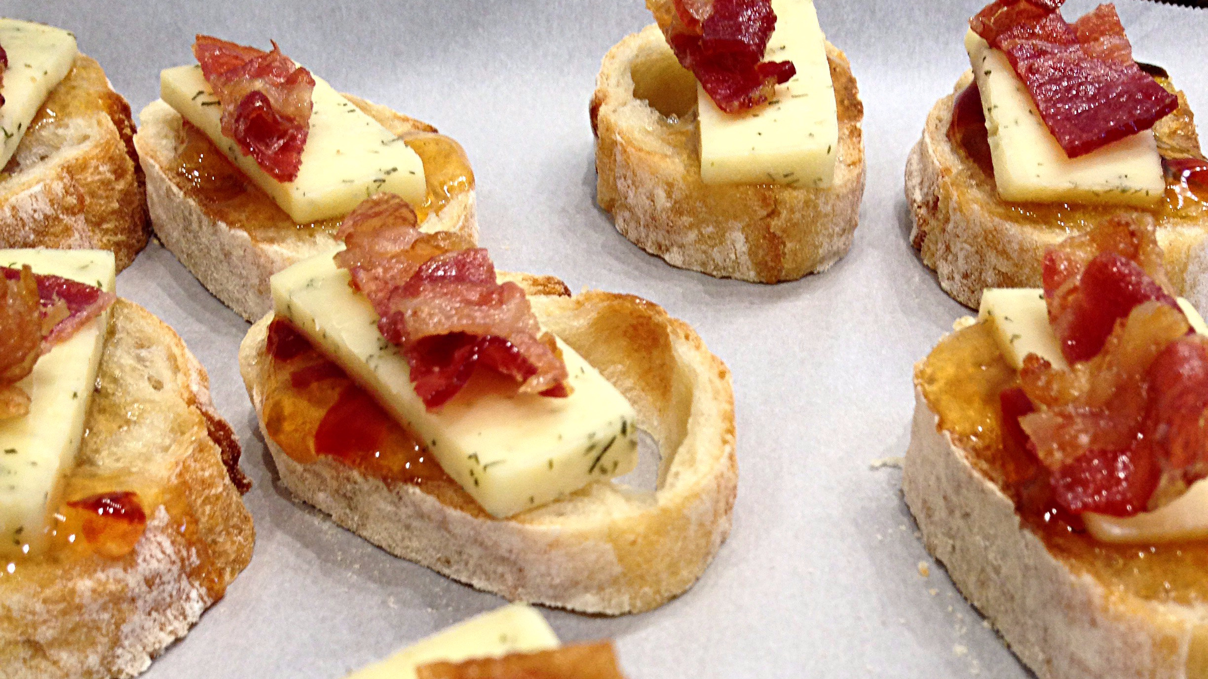 bacon crumbles are added on top of the baguette