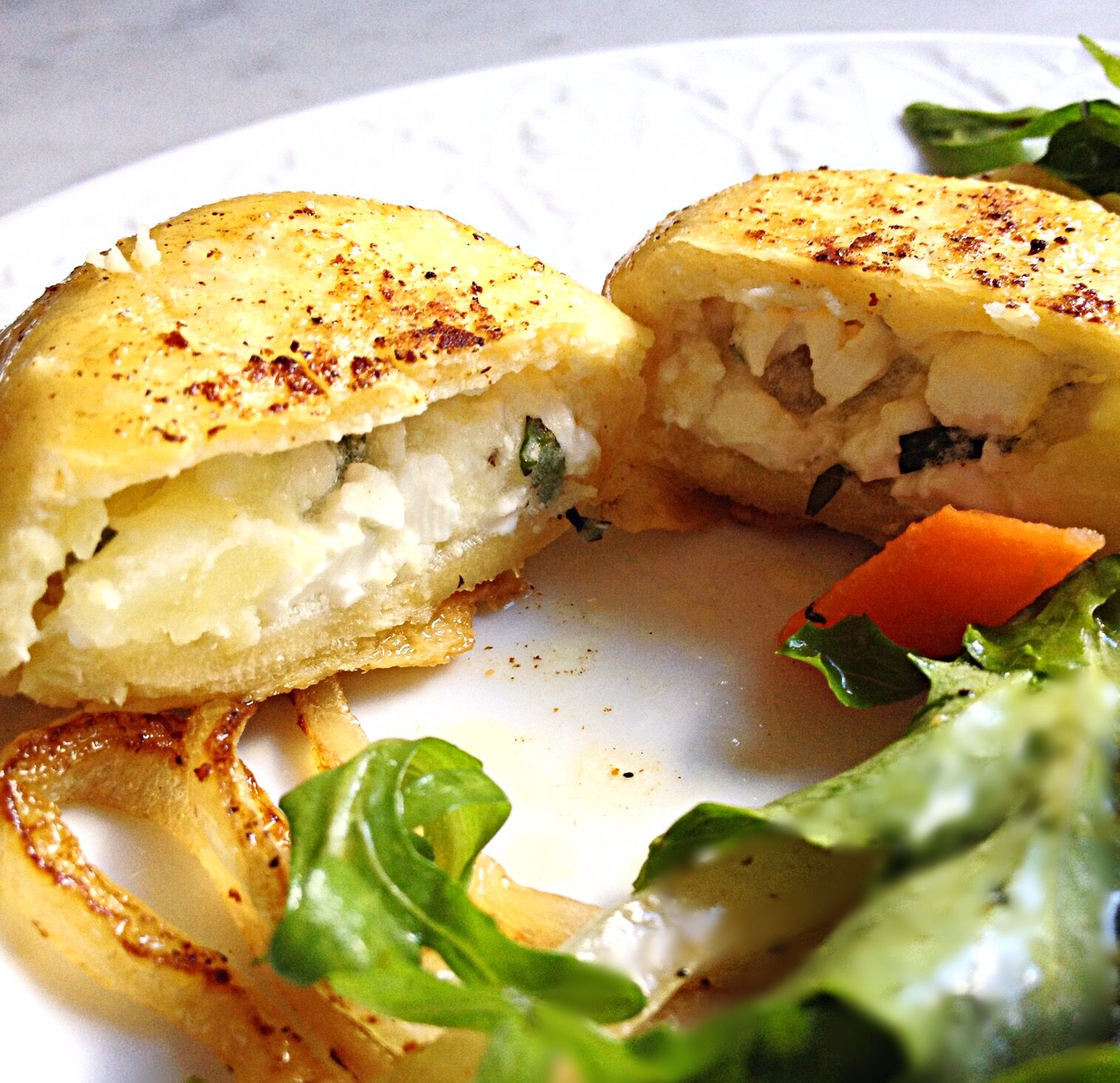 Photo Cheese and Potato Pierogi cut in half to reveal filling