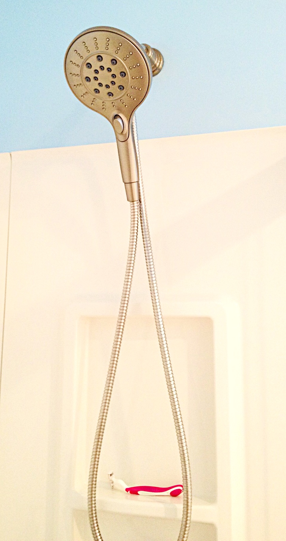 Photo of magnetic hand-held shower head