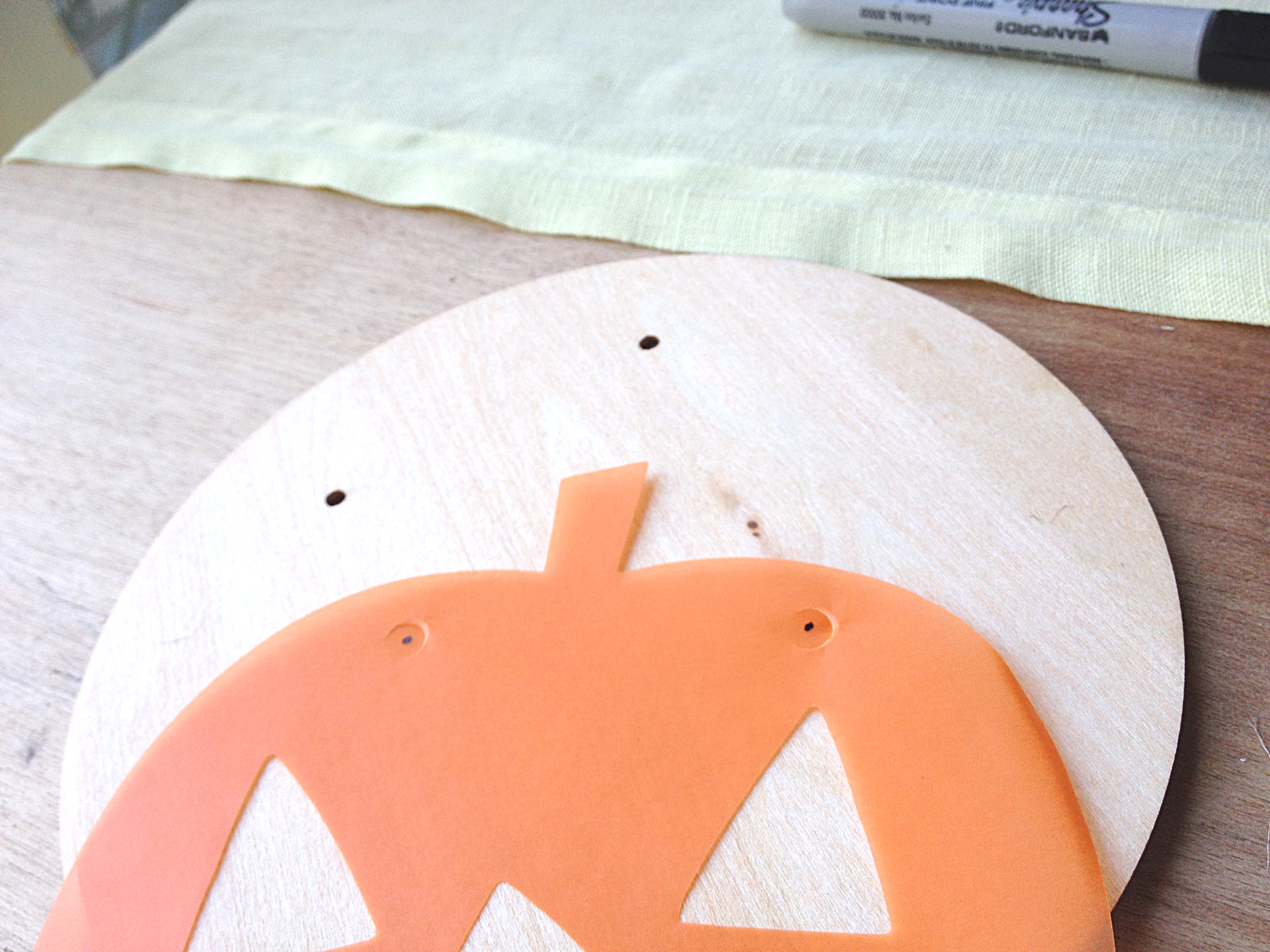 vellum pumpkin punched and ready to string on Halloween banner