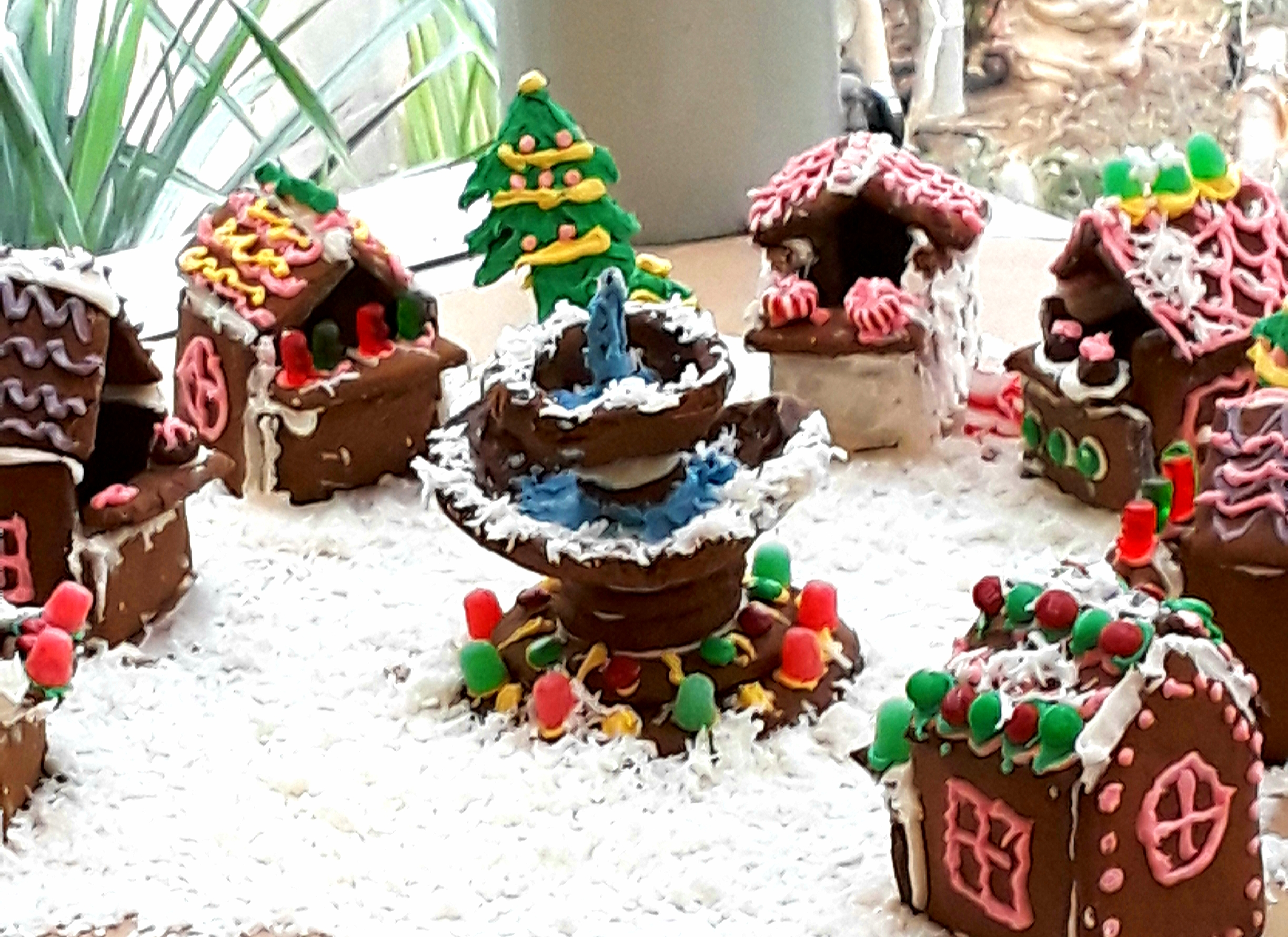 Gingerbread cottages surround a fountain made from cookies, frosting, and gumdrops