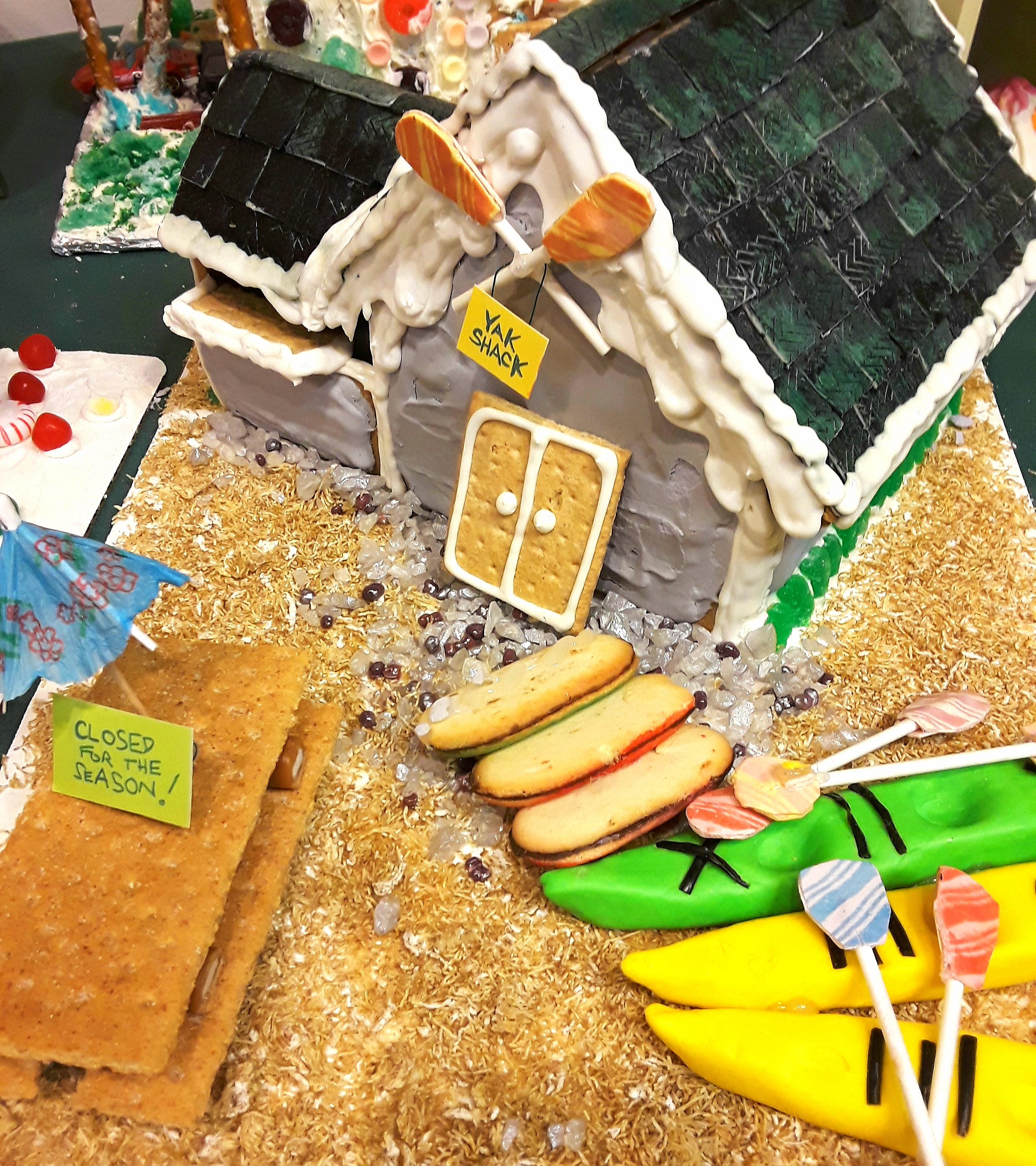 A gingerbread house decorated as a kayak rental center