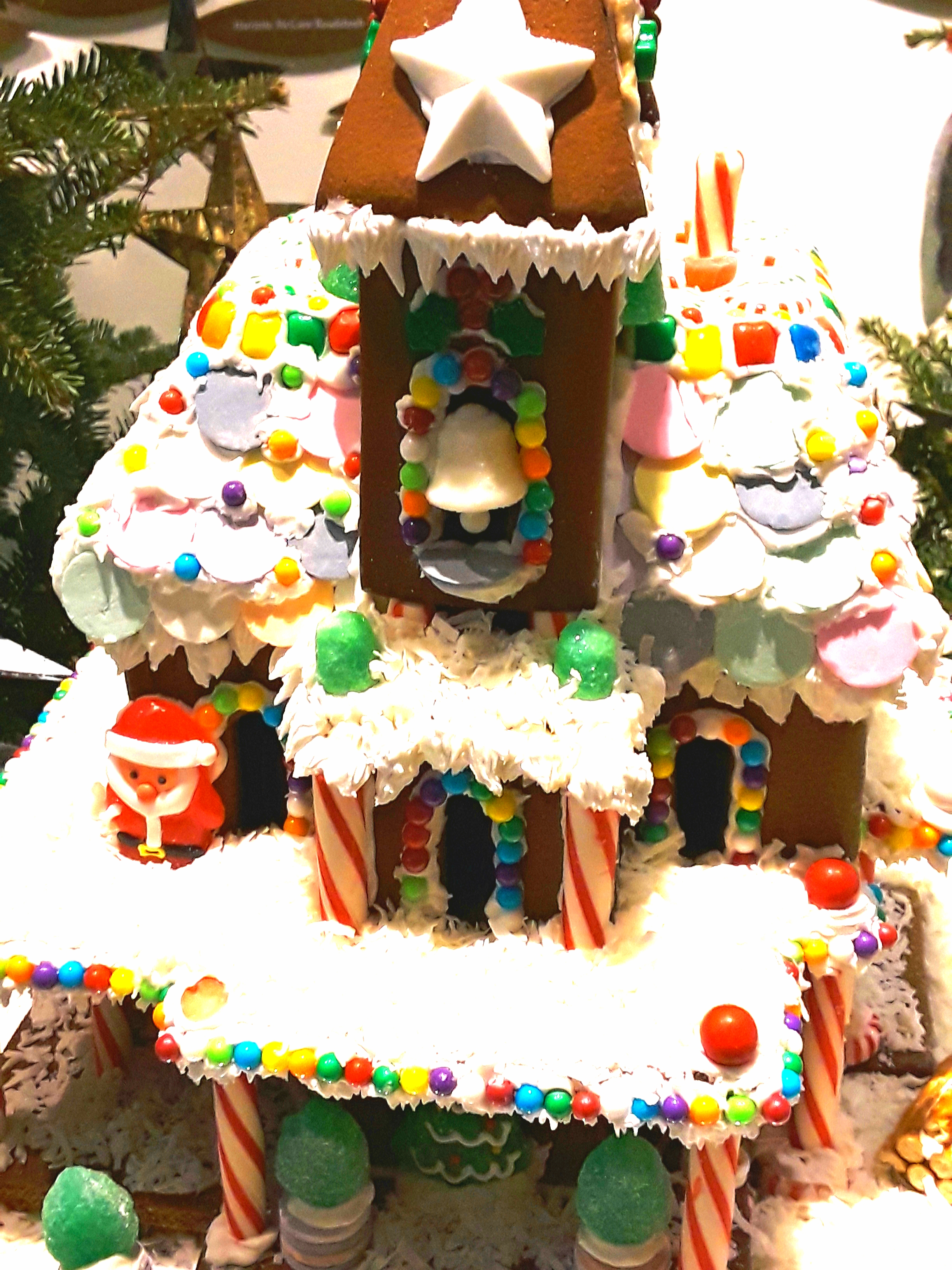 Three story gingerbread house with coconut snow on the roof