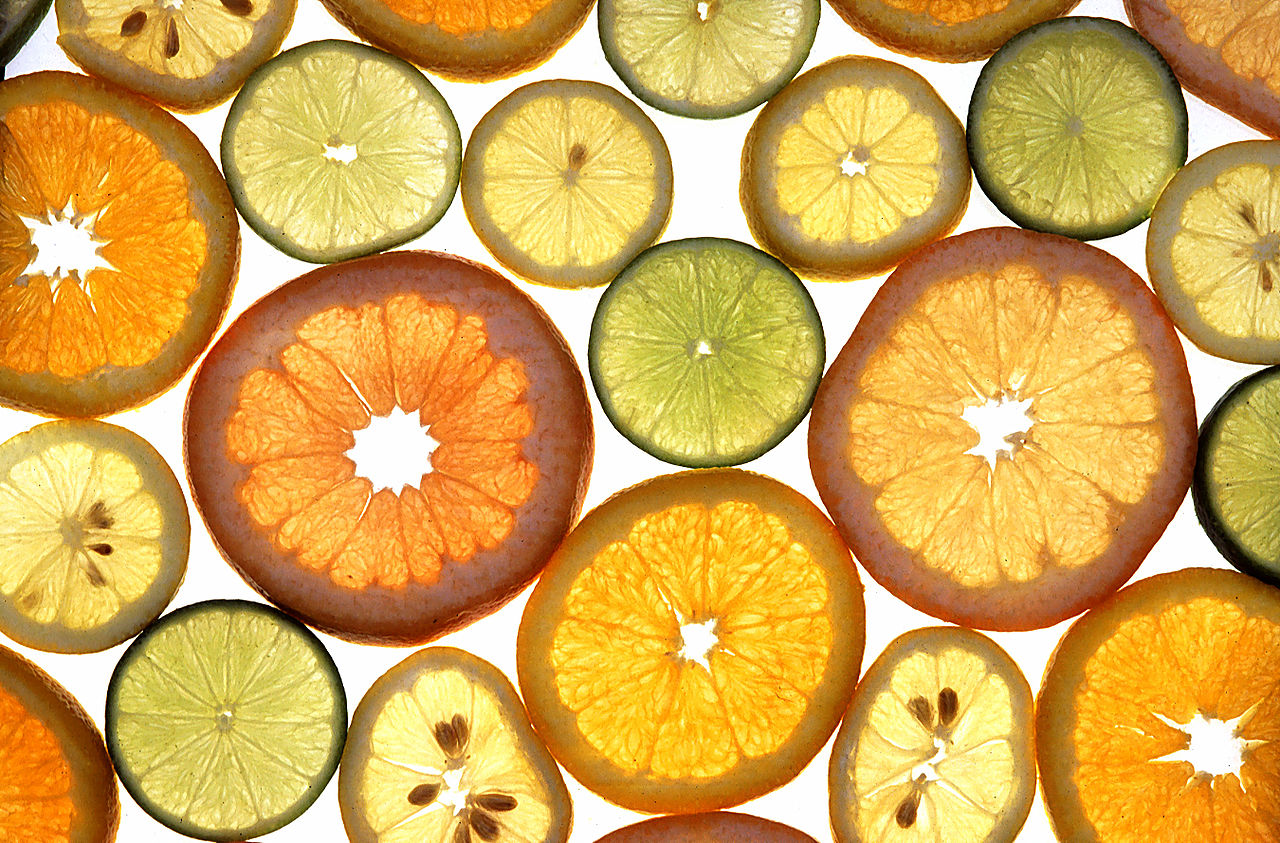 sliced grapefruit, limes, oranges, lemons