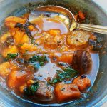 chorizo stew in blue bowl