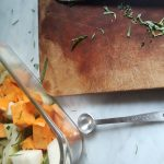 chopped herbs are added to peeled and cubed kohlrabi and sweet potato