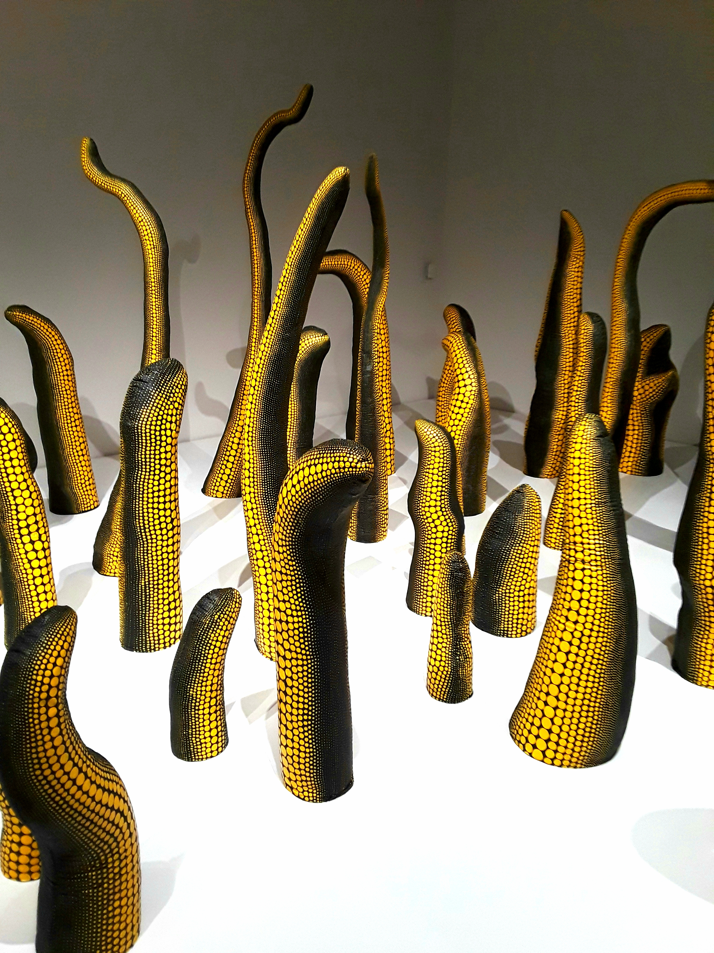 yellow and black sculptures resemble octopus tentacles