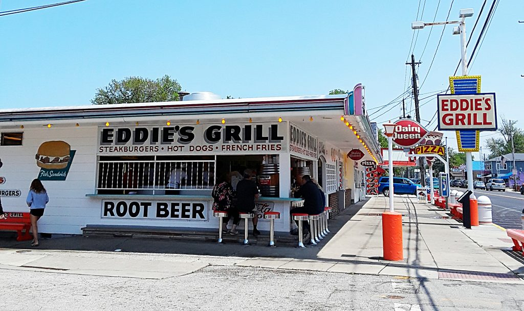 Hamburger and root beer stand with bar stool seating.