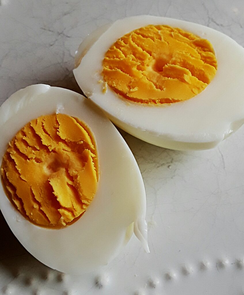 halved hard-boiled eggs show a rich yellow yolk