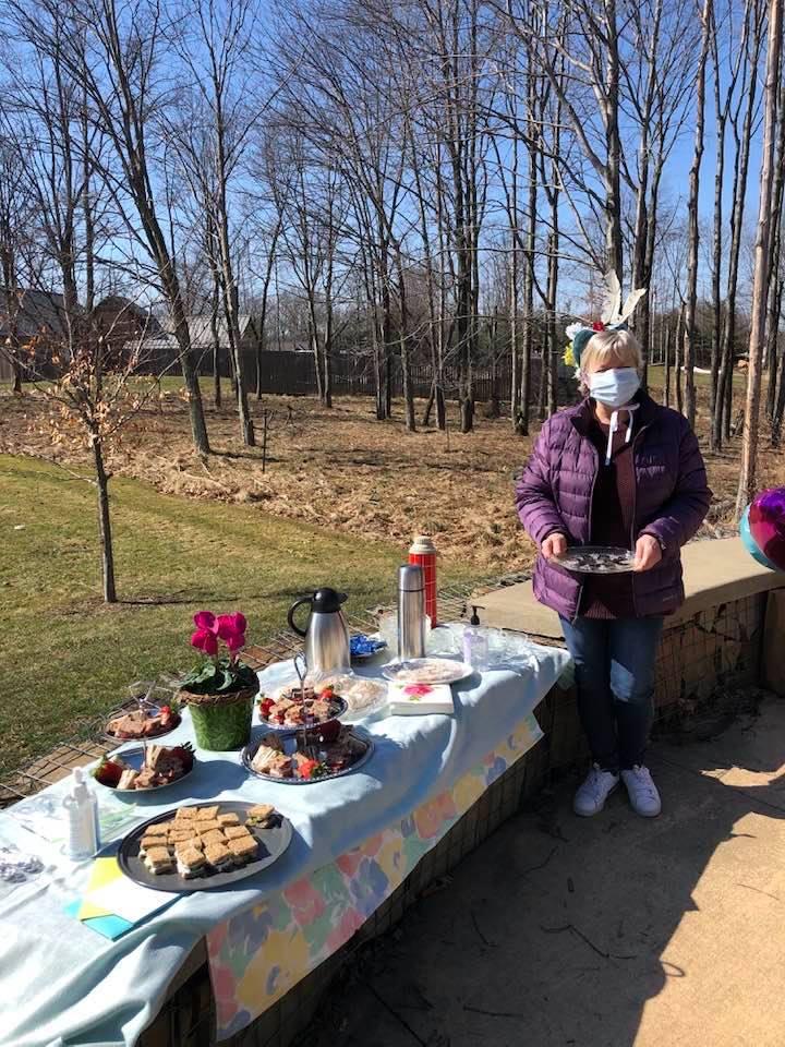 a tea party buffet set up outdoors as a picnic