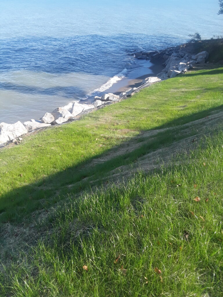 Large stone protects the shoreline.