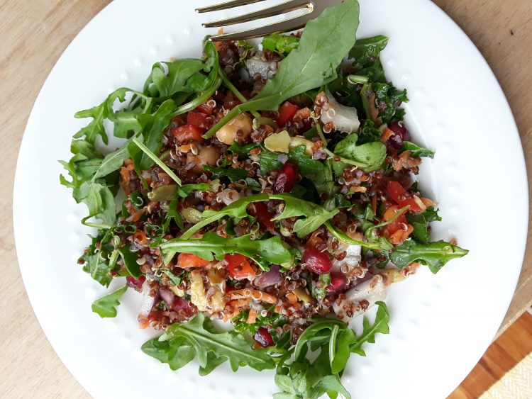 Quinoa, kale, arugula, seeds, nuts, veggies make a great superfood salad