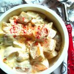 potato salad with sour cream and mayonnaise dressing, sprinkled with paprika