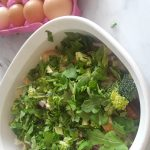 chopped greens are added to casserole dish