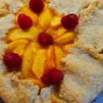 peach and raspberry galette is an open-faced pie