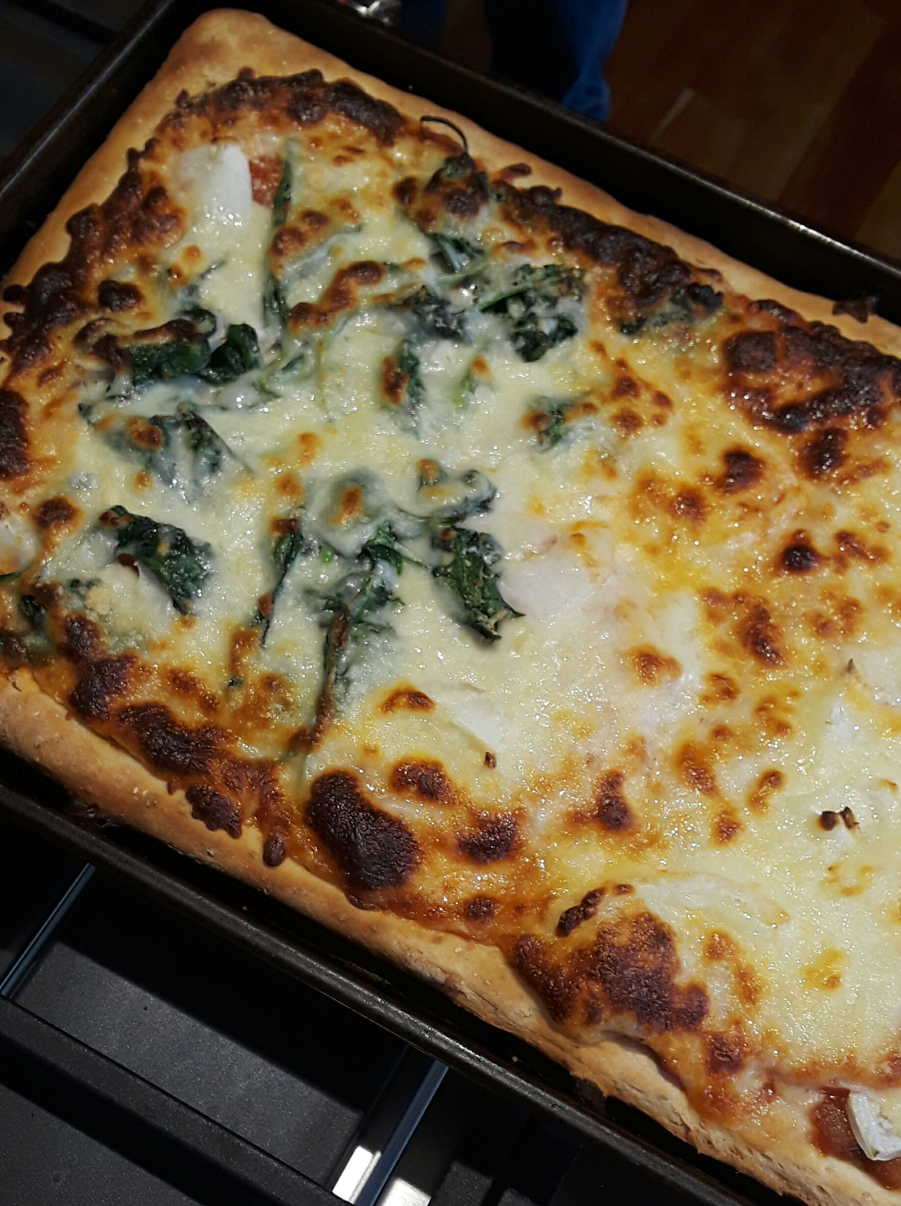 pizza with half spinach topping