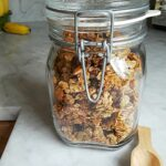 Homemade granola in lidded glass jar
