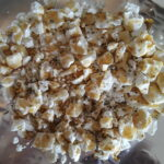 feta cheese is crumbled and topped with honey and thyme