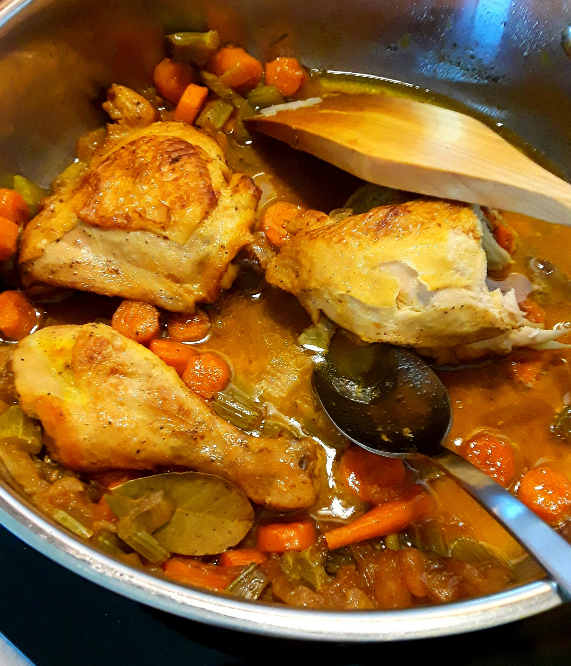 Caramelizing the chicken pieces with the chopped onions and carrots